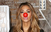 Singer Nicole Scherzinger wearing a red nose lights the Empire State Building red in celebration of Red Nose Day USA. Photograph: Richie Buxo/Splash News/Corbis